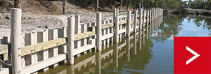 Vinyl sheet pile seawall in USA supported using earth anchors