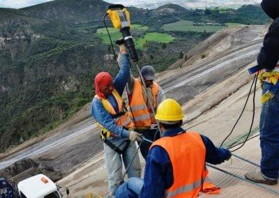 HCC, Quito, Ecuador - Installing Platipus earth anchor into slope