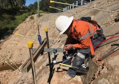 Mount Cotton Embankment - Redland, Australia - Man Loadlocking earth anchors with loadplate