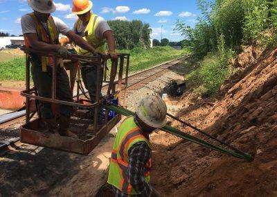 WSSU Slope Stabilization - Winston Salem - Driving earth anchors into slope