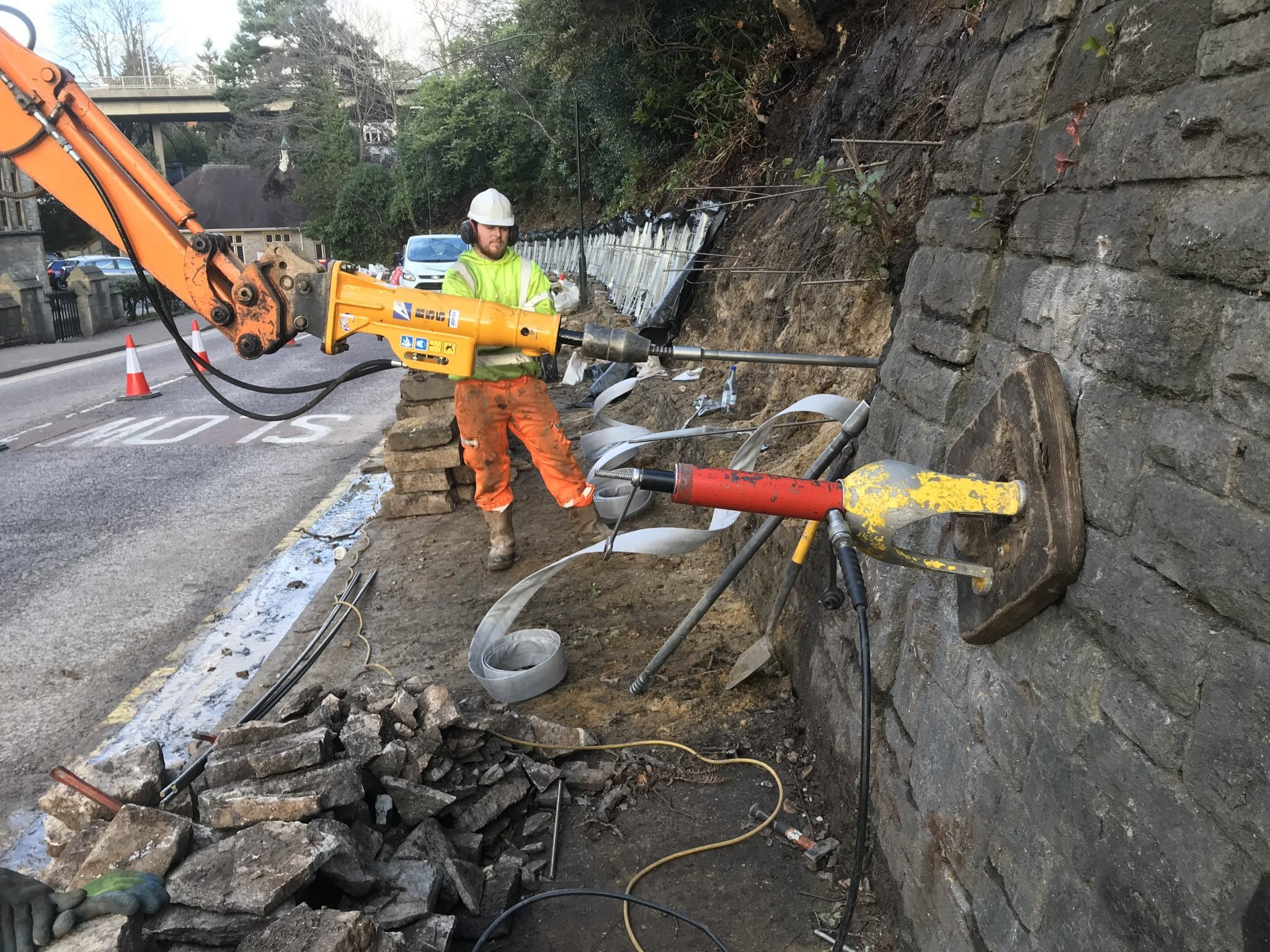St Stevens Road - Earth anchors installed - Platipus earth anchor being driven into slope