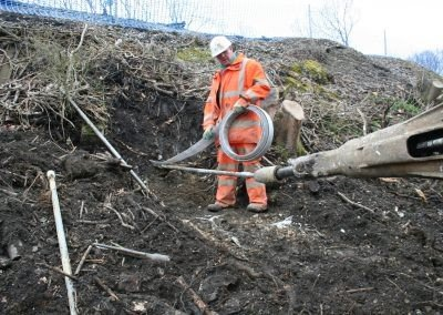 Burgess-Hill-Embankment-Strengthening Driving earth anchor into slope