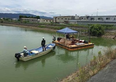 Workers on barge used to install Platipus anchors for the Ootsuda Ike Floating Solar Park in Kansai, Japan