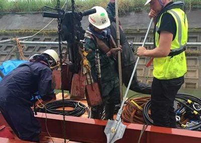Workers preparing to drive a Platipus B6 anchor for theOotsuda Ike Floating Solar Park in Kansai, Japan