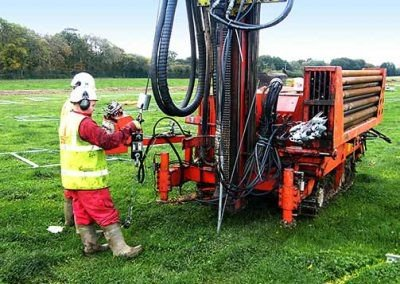 Driving a Platipus anchor using heavy machinery at the Redbridge Road solar park
