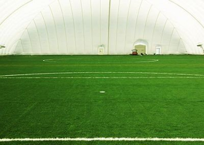 Football pitch inside an inflatable dome that is secured using Platipus Anchors