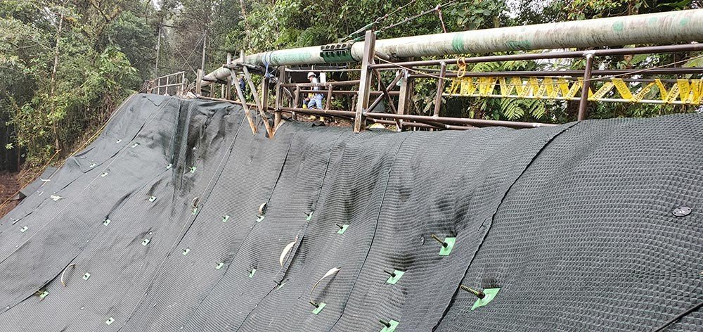 Pipeline Protection in Ecuador after installation of Platipus ground anchors and Plati-Drains to stabilise the slope