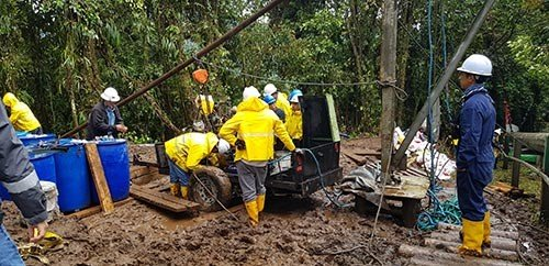 Heavy rainfall - setting up site after materials and equipment had been delivered by helicopter