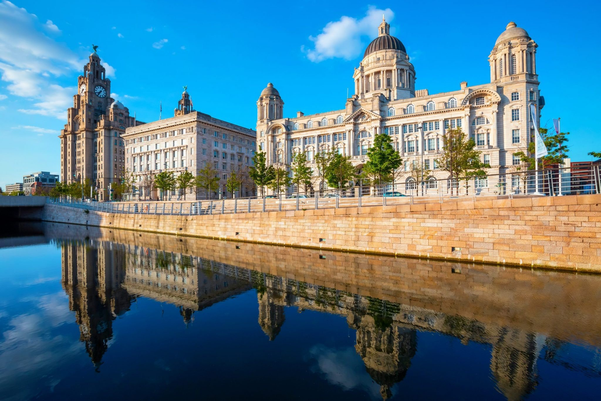 Liverpool, UK: Liverpool Pier Head with the Royal Liver Building, Cunard Building and Port of Liverpool Building part of the Liverpool Maritime Mercantile City UNESCO World Heritage Site